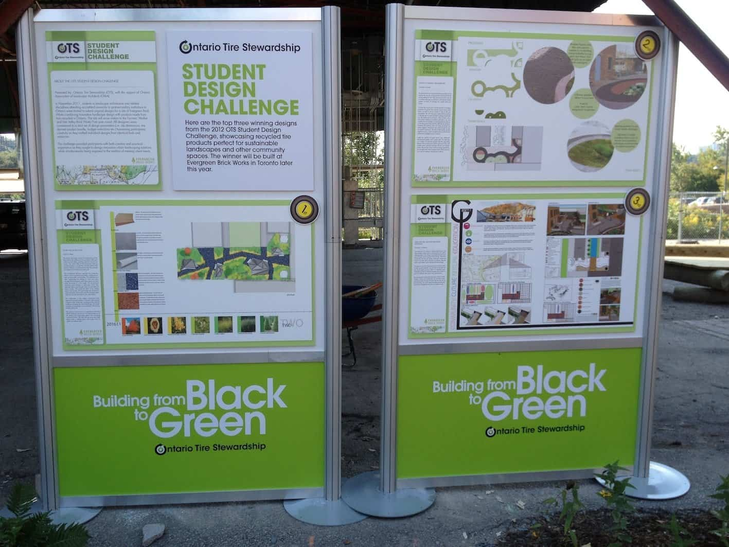Signs promoting the top three designs submitted in the Student Design Challenge at Evergreen Brick Works. The winning design is on the left.