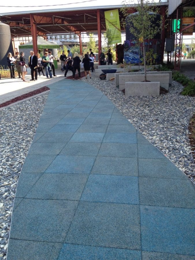 The blue-green path resembling a river at the newly designed site at Evergreen Brick Works.