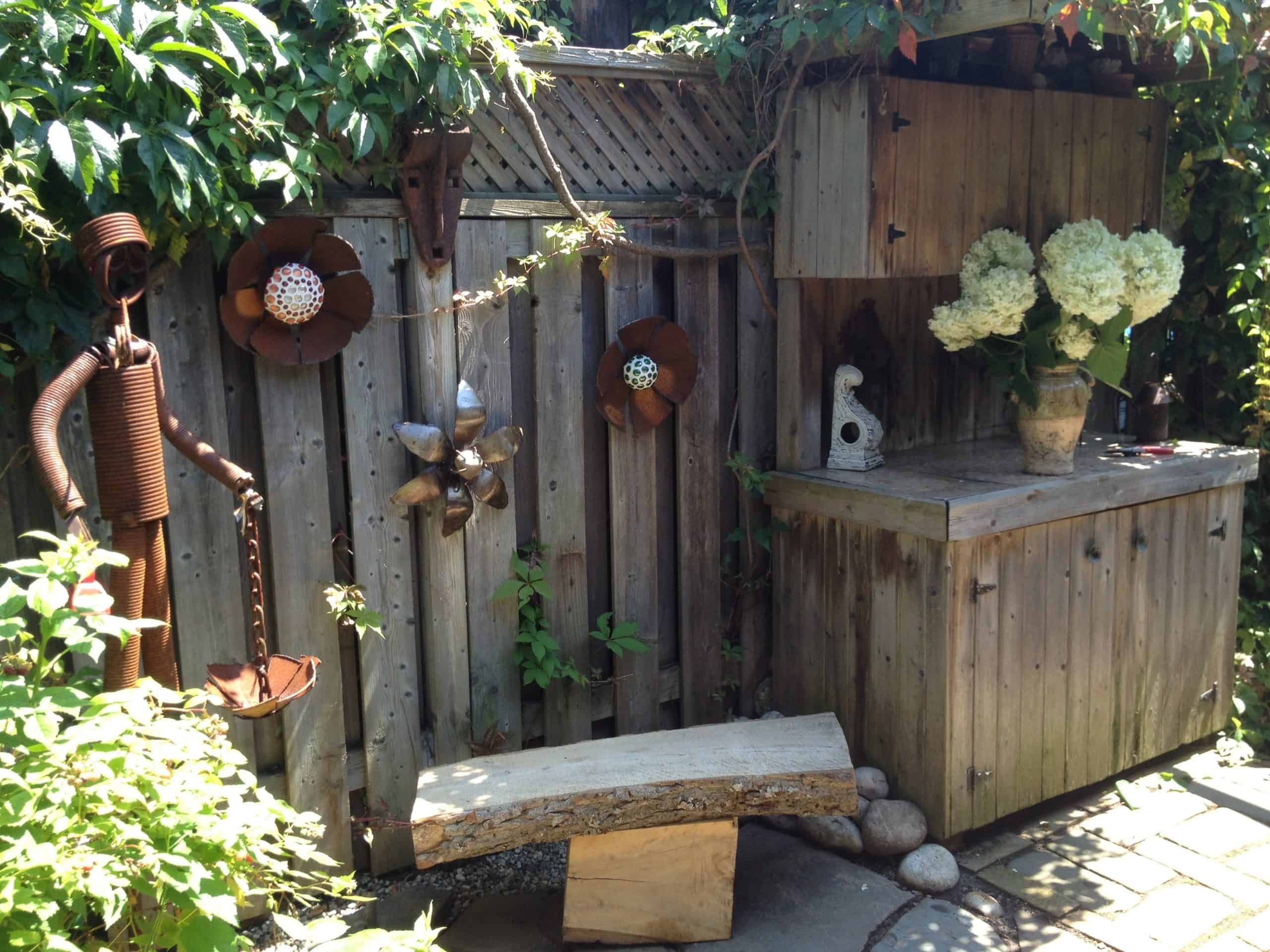 This garden was full of art, containers and bird baths made by one of the homewoners, from reclaimed materials.