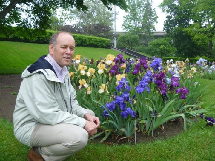 Carlo Balistrieri takes a break among the irises in the Laking Garden.
