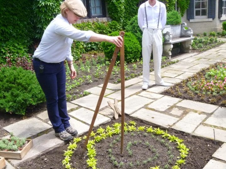 We learned how to use this wooden gadget to scribe a perfect circle in the flower beds.