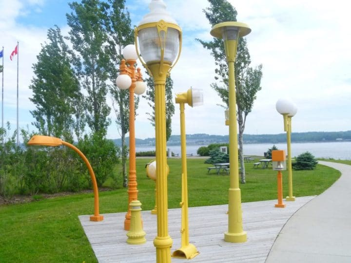 A fun art installation features the different styles of Quebec's vintage lampposts.
