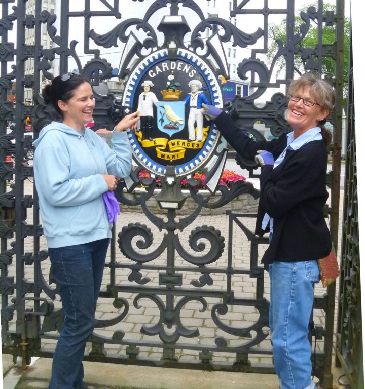 Tracy Jessen and Helen MacLean show off the refurbished Victorian gates.