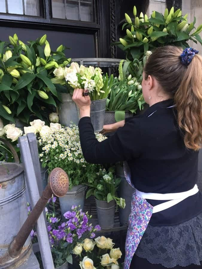 Making sure every bloom looks perfect in front of the store.