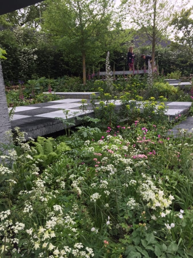 An estimated 40,000 squares of slate were used for this walkway. Lesson learned: Bold hardscaping looks best surrounded by subtle plantings.