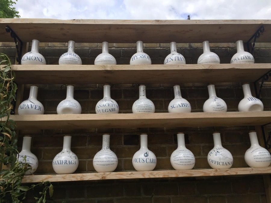 A section of a 36-porcelain jar collection by ceramic artist Nici Ruggiero. She based her design on apothecary jars that would have been used by early pharmacists.