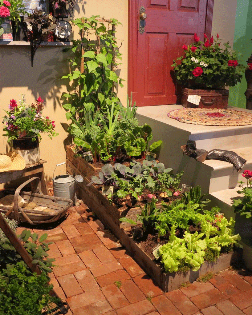Three stacked raised beds hold a selection of vegetables — a display garden at the 2016 Philadelphia Flower Show.