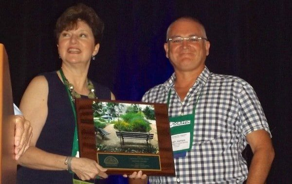 Sean James receiving a landscape design award from Jennifer Brennan, president of the Perennial Plant Association, who is with Chalet Nursery in Chicago.