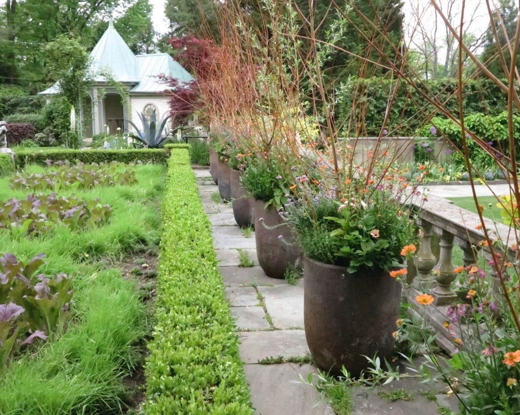 Rows of identically planted pots link two distinct planting areas at Chanticleer Garden in Pennsylvania. (Garden Making photo)