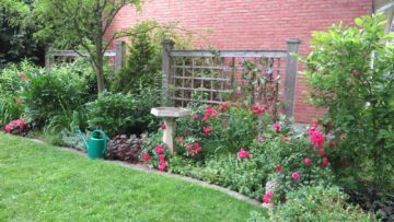Wide planting beds are easier to design because they provide space for focal points, such as birdbaths or columnar trees.