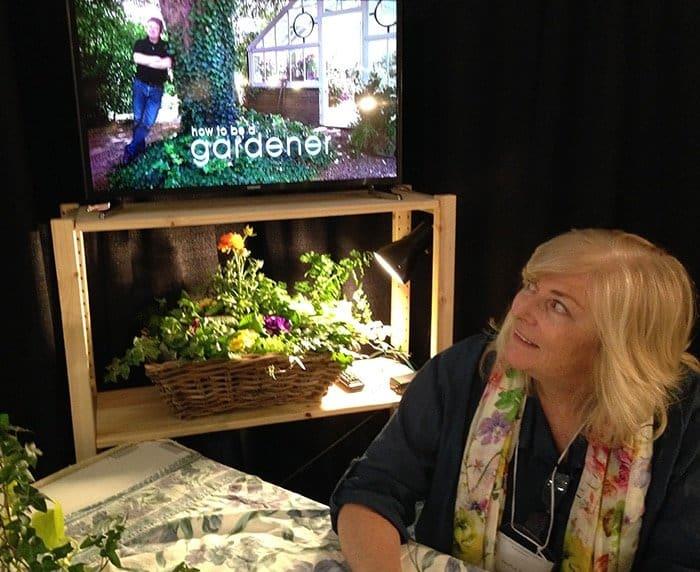 Liza Drozdov of Hortus TV at garden show explaining the new service.